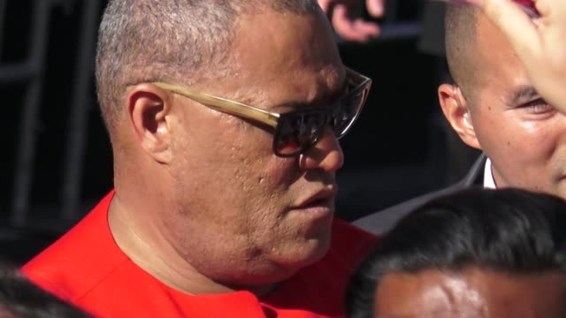 Laurence Fishburne signs for fans outside the AntMan and the Wasp premiere in Hollywood in Celebrity Sightings in Los Angeles