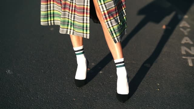 laury thilleman wears a multicolor checked trench coat, calzedonia socks, black heels shoes, outside koche, during paris fashion week womenswear... - カルツェドニア点の映像素材/bロール