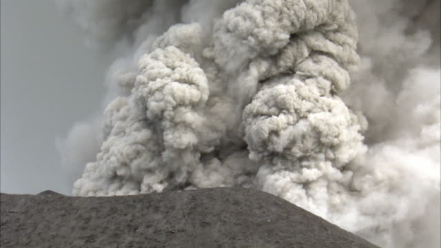 Lava bombs and ash blast out from erupting volcano, New Britain, PNG