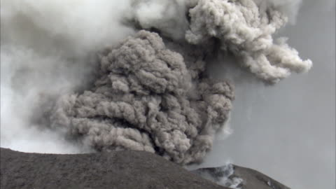 lava bombs and ash blast out from erupting volcano, new britain, png - volcano stock videos & royalty-free footage