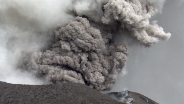 lava bombs and ash blast out from erupting volcano, new britain, png - erupting stock videos & royalty-free footage