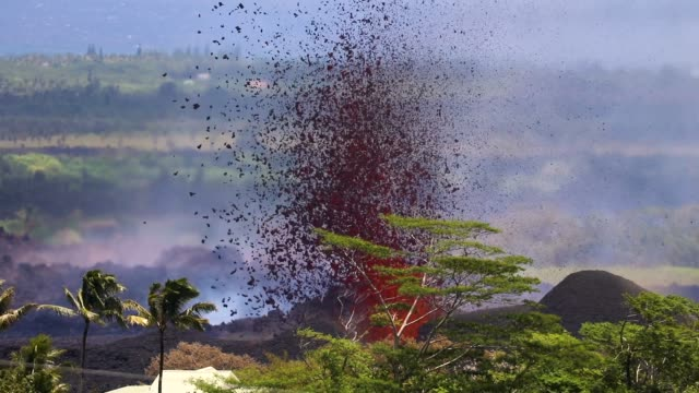 lava erupts and flows from a kilauea volcano fissure in leilani estates on hawaii's big island on may 23 2018 in kapoho hawaii officials are... - kilauea stock videos & royalty-free footage