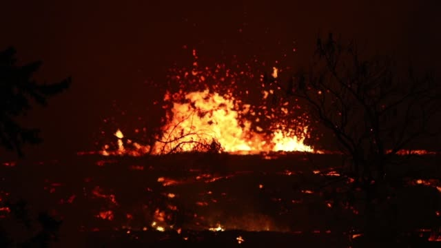 lava erupts and flows from a kilauea volcano fissure in leilani estates on hawaii's big island on may 23 2018 in kapoho hawaii officials are... - hydrochloric acid stock videos and b-roll footage