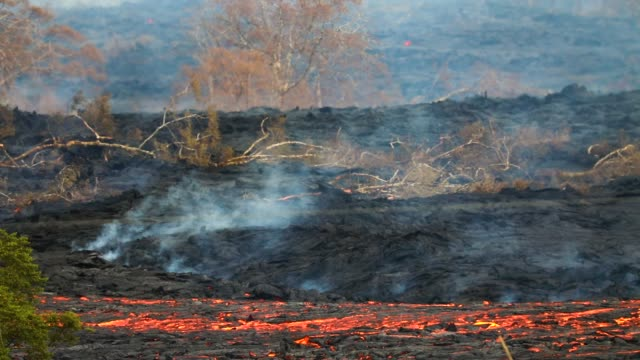 lava erupts and flows from a kilauea volcano fissure in leilani estates on hawaii's big island on may 23 2018 in kapoho hawaii officials are... - lava stock videos & royalty-free footage