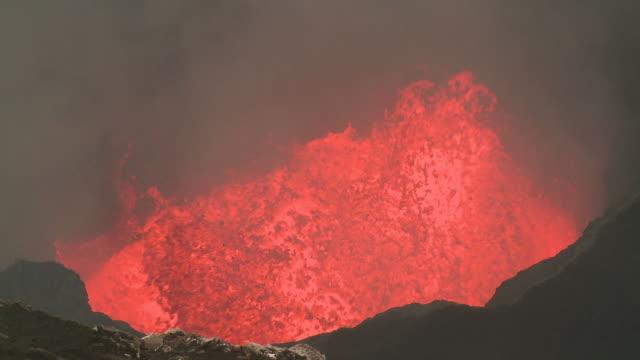 lava explodes onto crater wall, marum volcano, ambrym island, vanuatu - basalt stock videos & royalty-free footage
