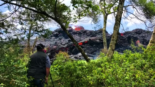 a lava fissure erupts in the aftermath of eruptions from the kilauea volcano on hawaii's big island on may 12 2018 in pahoa hawaii - kilauea stock videos & royalty-free footage