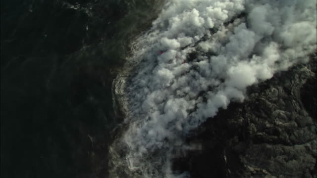 aerial ms lava flowing and forming steam cloud on ocean surface, hilo, hawaii, usa - tectonic stock videos & royalty-free footage