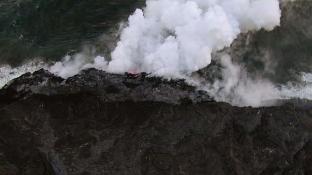 Lava flowing in to Pacific ocean from Kilauea volcano on the Island of Hawaii.