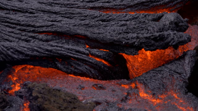 lava flowing texture close up 1 day daytime glowing hot flow from kilauea active volcano puu oo vent active volcano magma - lava stock videos & royalty-free footage