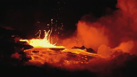 ws lava from kilauea volcano exploding at night / kalapana, hawaii, usa - lava stock videos & royalty-free footage
