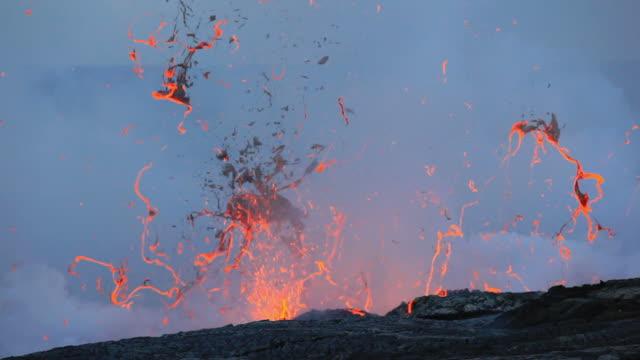 ws lava from kilauea volcano exploding / kalapana, hawaii, usa - lava stock videos & royalty-free footage