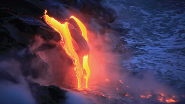 ms ha lava from kilauea volcano falling into ocean at dawn / kalapana, hawaii, usa - lava stock-videos und b-roll-filmmaterial