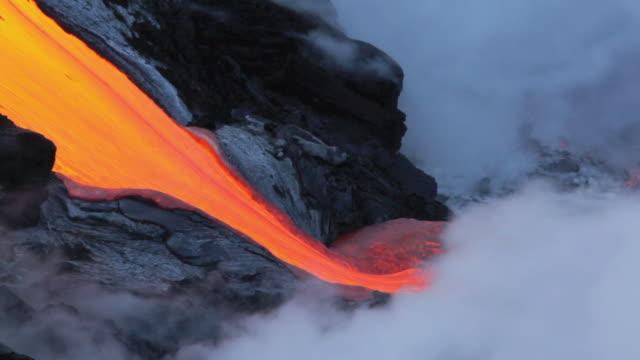 T/L MS Lava from Kilauea volcano falling into ocean / Kalapana, Hawaii, USA