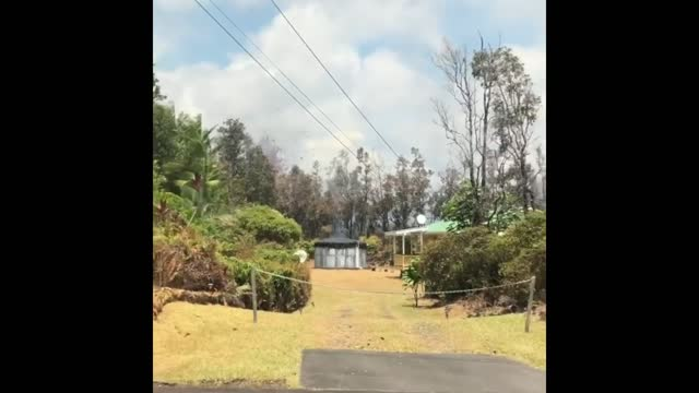 lava from the kilauea volcano engulfed cars and threatened homes in the east rift zone of hawaii's big island as two new lava vents opened on sunday... - https stock-videos und b-roll-filmmaterial