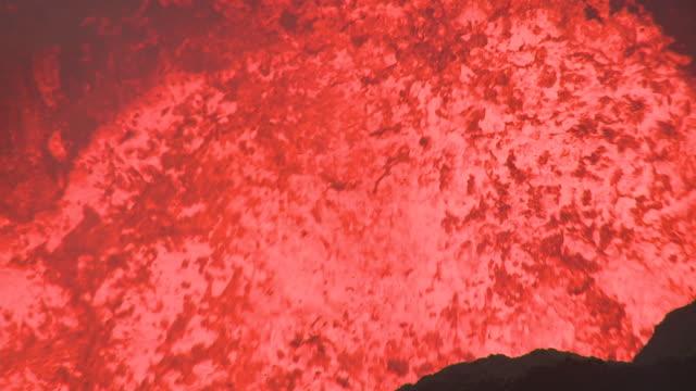 lava lake surges dramatically at night, marum volcano, ambrym island, vanuatu - igneous stock videos & royalty-free footage