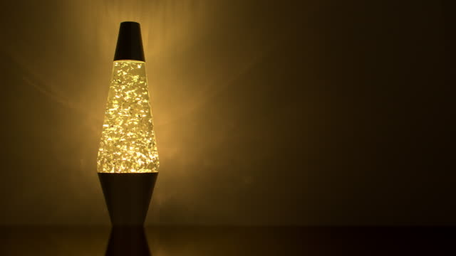 lava lamp and reflection on a wall. - electric lamp stock videos & royalty-free footage