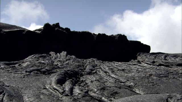 stockvideo's en b-roll-footage met a lava ledge lies above other lava formations. - vensterbank