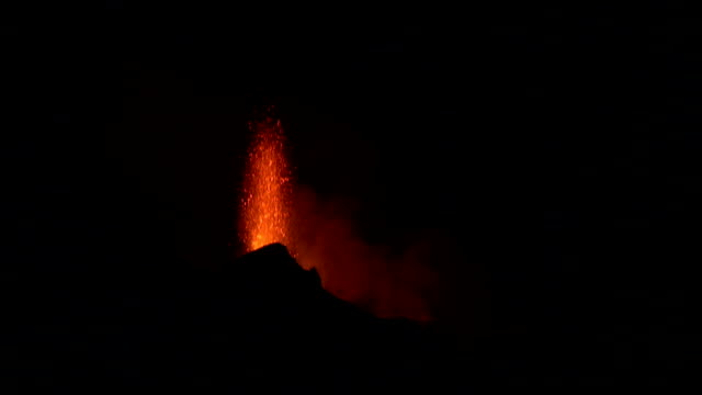 Lava shoots from a volcano. Available in HD.