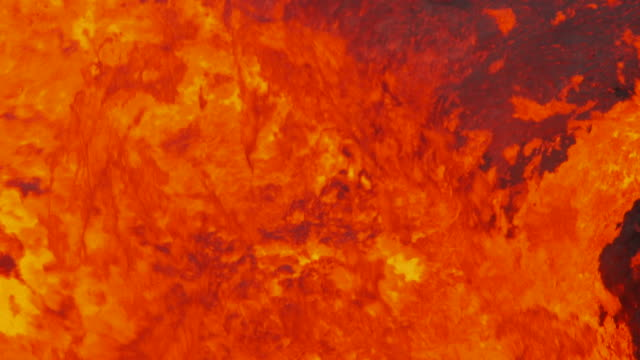 lava splashes noisily against the edge of a lava lake in a volcano on ambrym, vanuatu [filmed at 50fps and maintained at half speed]. - boiling stock videos & royalty-free footage