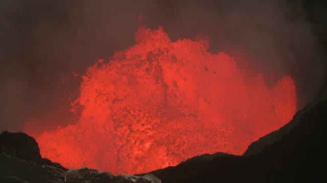 Lava surges in crater at dusk, Marum Volcano, Ambrym Island, Vanuatu