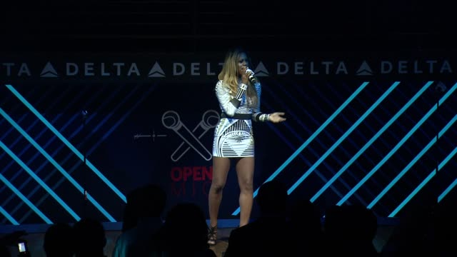 PERFORMANCE Laverne Cox at The Delta OPEN Mic With Serena Williams at Arena NYC on August 20 2014 in New York City
