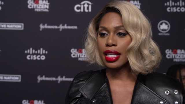 interview laverne cox on the johnson johnson partering with red to help aids prevention and treatment on what this festival is about at 2019 global... - great lawn stock videos and b-roll footage