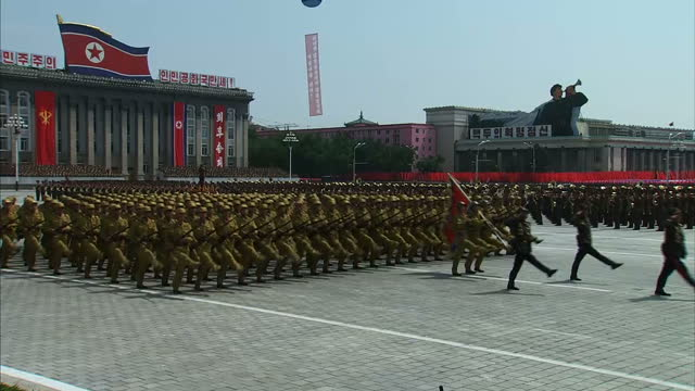 lavish array of troops, military vehicles and hundreds of performers have put on a show in north korea as part of celebrations to mark the 60th... - korean war stock videos & royalty-free footage