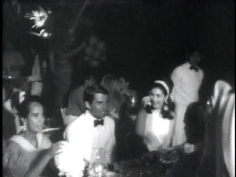 Lavish dinner party in Acapulco movie stars dining and dancing / Acapulco Mexico USA