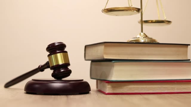 law and justice concept background, scales of justice, books. - bestrafung stock-videos und b-roll-filmmaterial