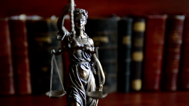 law concept image with scales of justice with law books - statue stock videos & royalty-free footage