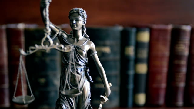 law concept image with scales of justice with law books - lady justice stock videos and b-roll footage