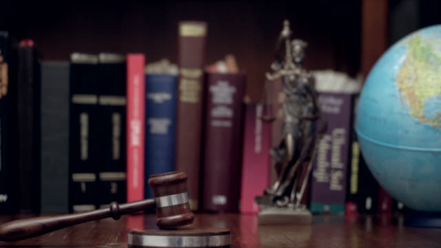 law concept image with scales of justice with mallet - law stock videos & royalty-free footage