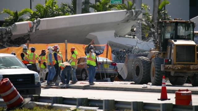 Law enforcement and members of the National Transportation Safety Board continue their investigation into a pedestrian bridge that collapsed...