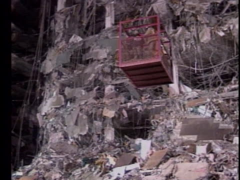 law enforcement officials examine the mangled remains of the bombed murrah federal building in oklahoma city. - oklahoma city bombing stock videos & royalty-free footage