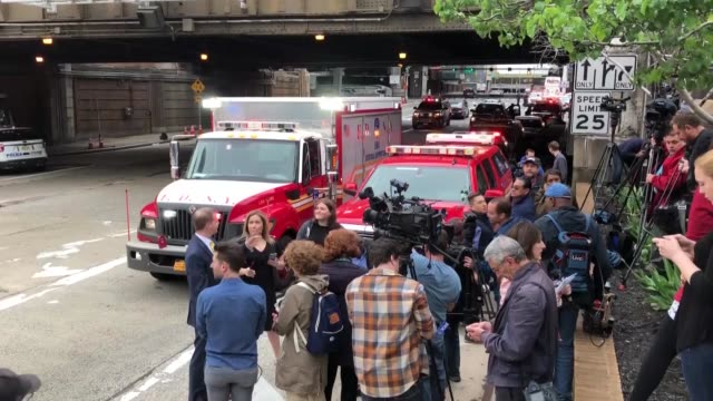 law enforcement officials gather near the scene of a new jersey transit bus that was involved in a morning crash near the manhattan entrance to the... - fire department of the city of new york stock videos and b-roll footage