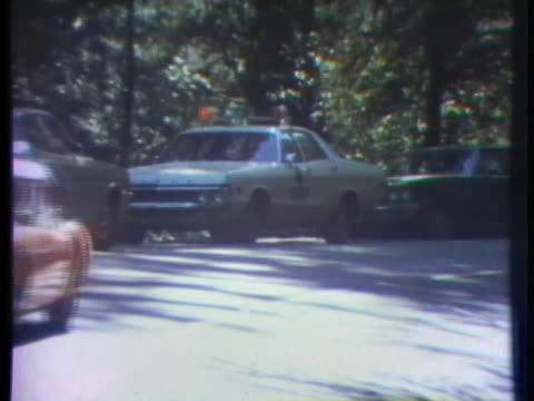 law enforcement officials search for a serial murderer who committed 13 bloody murders in six weeks in santa cruz, california in 1973. - カリフォルニア州サンタクルーズ点の映像素材/bロール