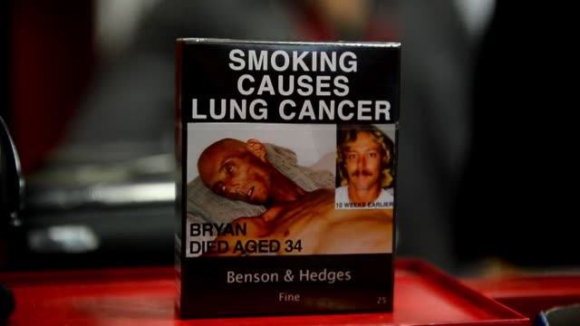 law forcing tobacco firms to sell cigarettes in plain packets came into effect in australia on saturday in an effort to strip any glamour from... - portionspåse bildbanksvideor och videomaterial från bakom kulisserna
