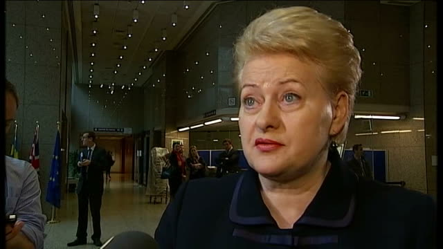 law makes crimea part of russia / eu sanctions extended belgium brussels reporter to camera sot reporter talking to dalia grybauskaite dalia... - 制裁点の映像素材/bロール