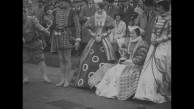 lawn bowlers in elizabethan-era costumes prior to a lawn bowling game to reenact the legendary story of sir francis drake's waiting to finish a lawn... - ball stock videos & royalty-free footage