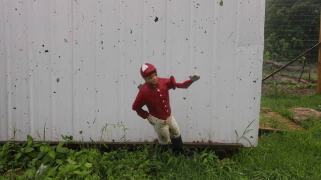 Lawn jockey sitting in the damage debris after an EF1 tornado with 130 mph winds made an 822 mile path Saturday June 15 2019 near Ellettsville Ind...