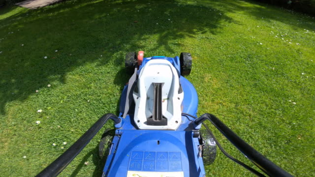 lawn mower point of view shot on lush green lawn. - audio available stock videos & royalty-free footage