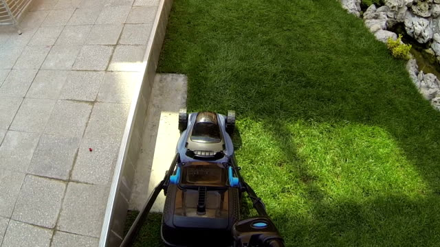 hd: pov lawn mower - lawn mower stock videos and b-roll footage