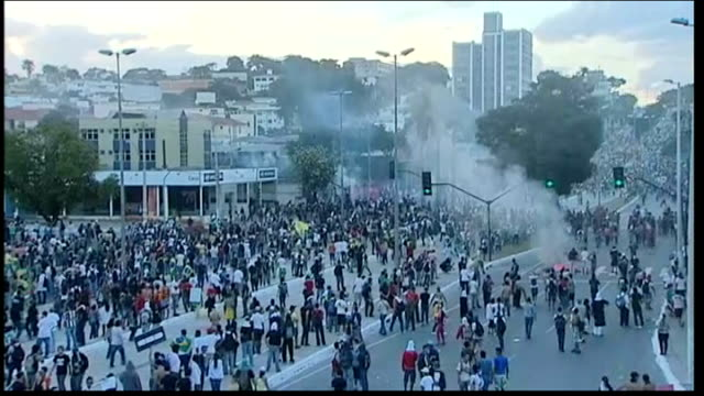 laws against political corruption hurried through parliament brazil fortaleza belo horizonte ext crowd of protesters near to stadium where semifinal... - covering stock videos & royalty-free footage