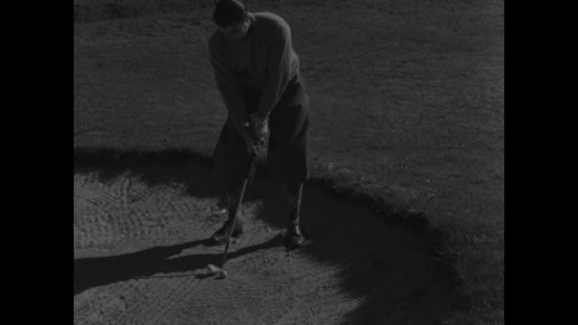 vs lawton little tees off drives ball from sand trap putts and sinks ball during match play in the walker cup at the old course at st andrews scotland - schottland stock-videos und b-roll-filmmaterial