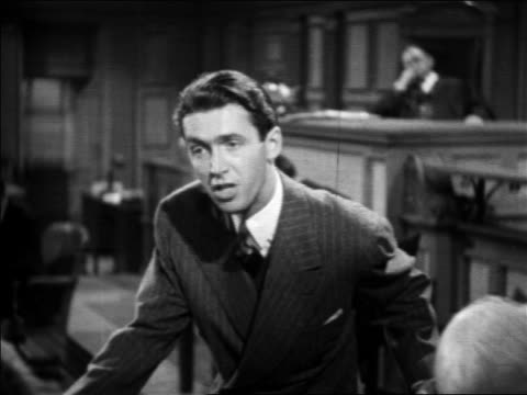 b/w 1939 lawyer addressing jury with impassioned plea in court trial / feature - gerichtssaal stock-videos und b-roll-filmmaterial