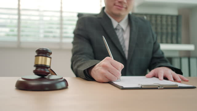 lawyer businessman working and notary signs the documents at office. consultant lawyer, justice and law ,attorney, court judge, concept. - judge stock videos & royalty-free footage