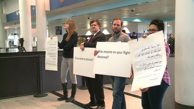 wgn lawyers at o'hare airport looking to help traveler's detained due to trump's travel ban on february 4 2017 - detainee stock videos & royalty-free footage