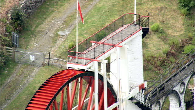 laxey wheel  - aerial view - laxey, isle of man - isle of man stock videos & royalty-free footage