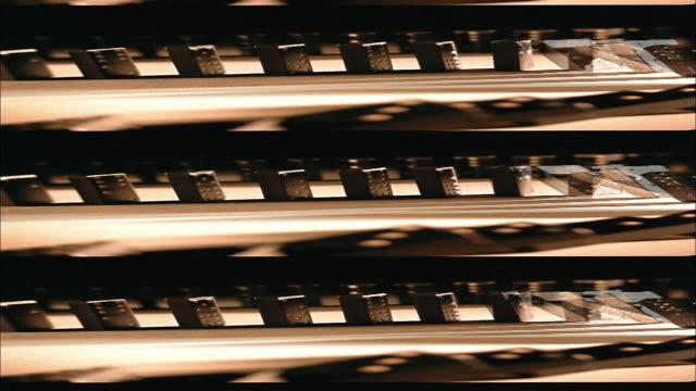 vídeos y material grabado en eventos de stock de tinted rewind layered effect of dominoes falling in line - imagen virada