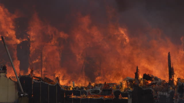layered flames rise from the remains of a house being consumed by fire - myrtle creek stock videos and b-roll footage